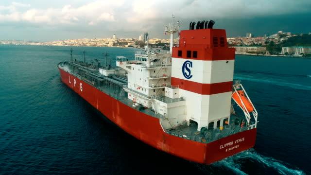 ship crossing bosphorus (drone shot) - cargo ship stock videos & royalty-free footage