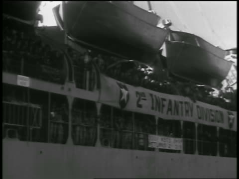 b/w 1954 ship crowded with soldiers pulling into port / seattle / newsreel - 1954 stock videos and b-roll footage