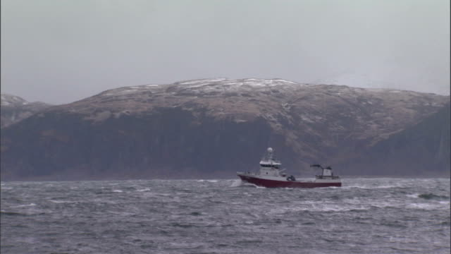 a ship cruises in a stormy sea off the west coast of scotland. available in hd. - nautical vessel stock videos & royalty-free footage