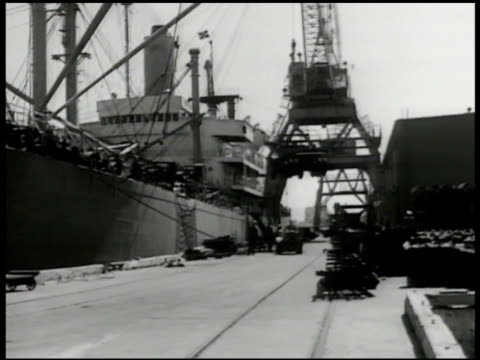 ship docked at pier crane loading military truck ha ms dock workers operating crane la ms truck hoisting on crane korean war korean conflict war... - hoisting stock videos & royalty-free footage