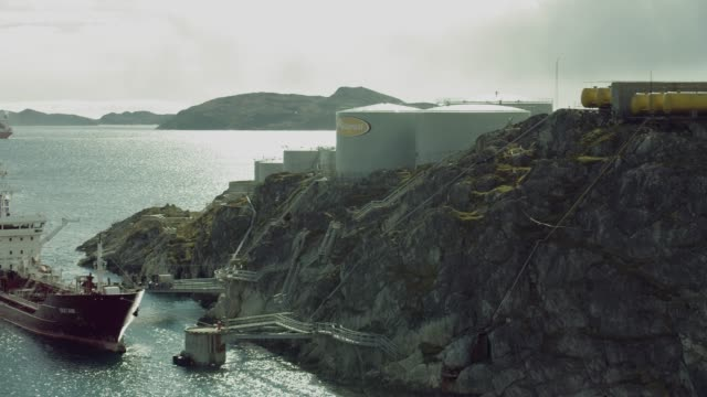 ship docks along port in nuuk greenland - oil tanker stock videos and b-roll footage
