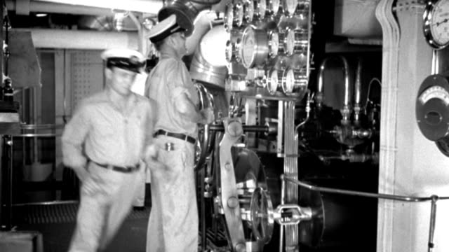 int - ship engine room - parts of boat - machinery - engine romm diesel liner - very clean and shiny - valves gauges - a few men run in excited as if in emergency - b&w. - gauge stock videos & royalty-free footage