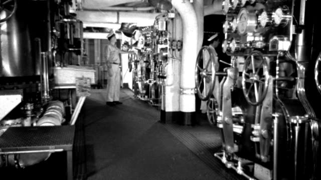 int - ship engine room - parts of boat - machinery - engine romm diesel liner - very clean and shiny - valves gauges - a couple men on checking instruments - no excitement - b&w. - gauge stock videos & royalty-free footage
