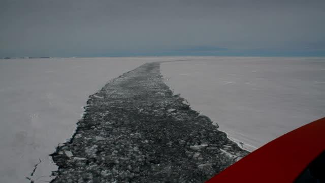 POV ship following pathway through broken ice sheets, Antarctica