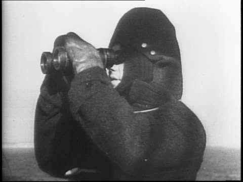 Ship in rough sea / sailors wearing hoods looking through binoculars / parcels addressed to 'Fur Vest Project' / men take coats out of packages piled...