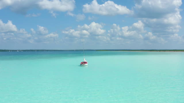 a ship in the paradise white sand beach island in the caribbean bacalar lagoon, mexico - lagoon stock videos & royalty-free footage