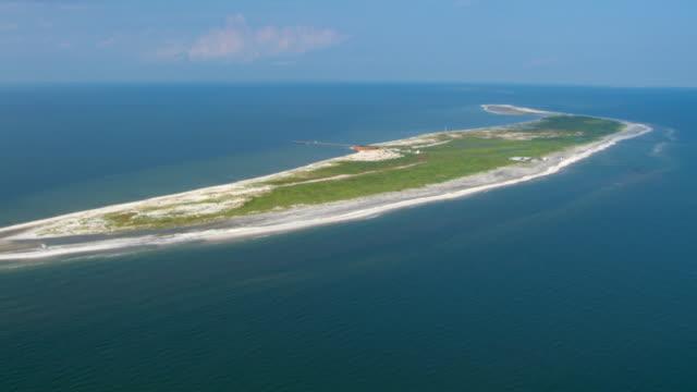 Ship Island curves along the Gulf Islands National Seashore.