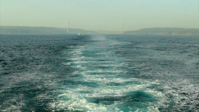 ship leaves the bosphorus (slow motion) - nautical vessel stock videos & royalty-free footage