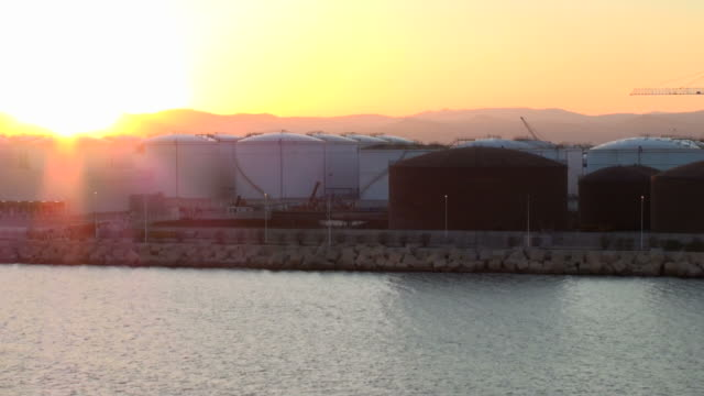 Ship leaving Barcelona harbor at sunset, Spain