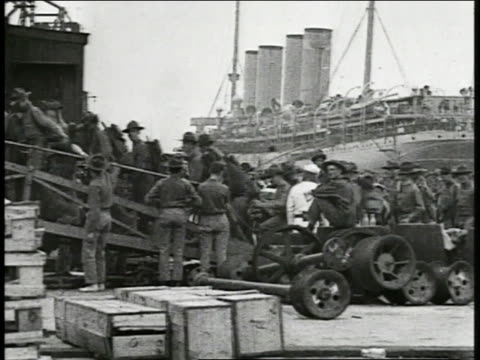 ship leaving dock filled w/ soldiers some soldiers waving most standing sitting on deck pan deck filled w/ soldiers - anno 1918 video stock e b–roll