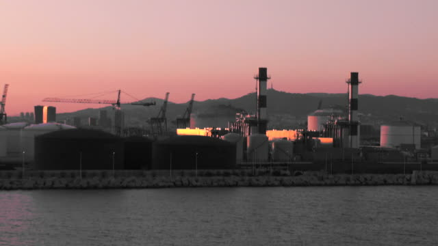 Ship leaving the harbor at sunset