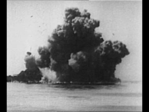 Ship lists after being torpedoed / torpedoed ship sinks / montage ship explodes after being torpedoed and goes underwater / rear shot US destroyer...