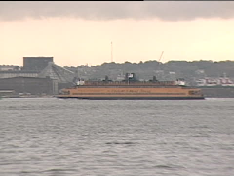 ship makes it way on the east river during golden-hour. - golden hour stock videos & royalty-free footage