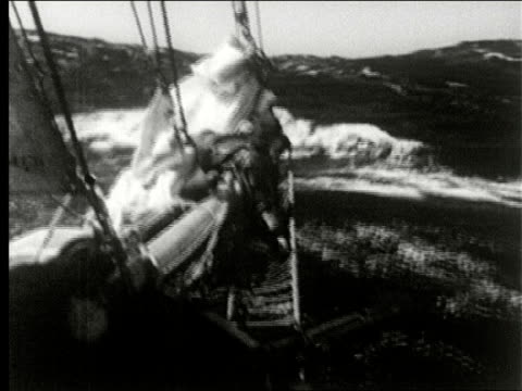 ship passes cape horn sails through rough seas / sailor in foul weather gear at ship steering wheel man pointing with girl and boy high waves... - helm stock videos & royalty-free footage