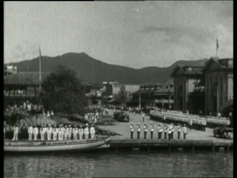 b/w ship point of view of soldiers standing in formation on shore / port of spain trinidad / no - west indies stock videos & royalty-free footage