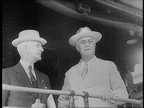 ship 'potomac' cruises through water / press photographers snap pictures / franklin roosevelt harry hopkins and others stand on deck of ship /... - cordell hull stock videos and b-roll footage