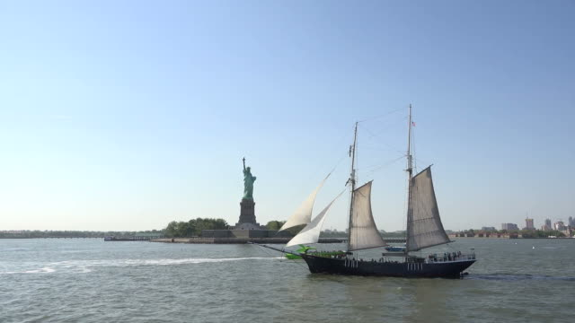 ship sailing in new york city bay with statue of liberty behind - memorial plaque stock videos and b-roll footage