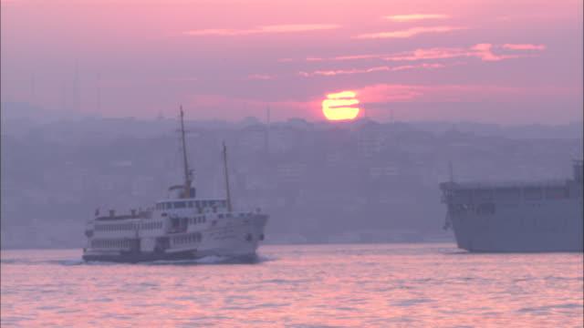 ms, ship sailing on water at sunset, istanbul, turkey - イスタンブール点の映像素材/bロール