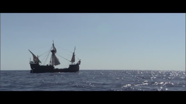 a ship sails on the open ocean. - medieval stock videos & royalty-free footage