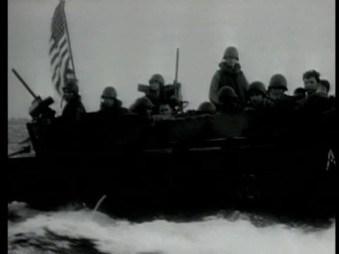 us ship shelling hollandia us allied soldiers in landing barge moving in water lb docking on beachhead us soldiers driving jeep out of barge... - pacific city stock videos & royalty-free footage