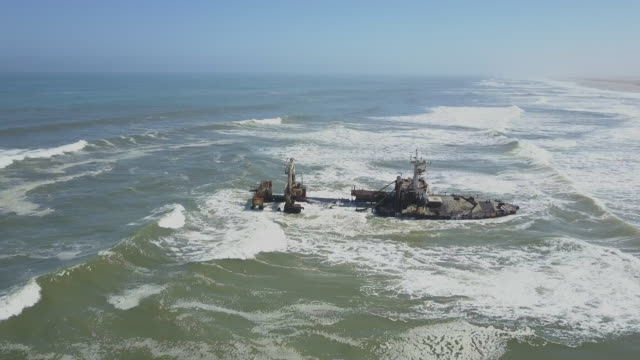 a ship shipwreck near a beach in africa. - chance concept stock videos & royalty-free footage