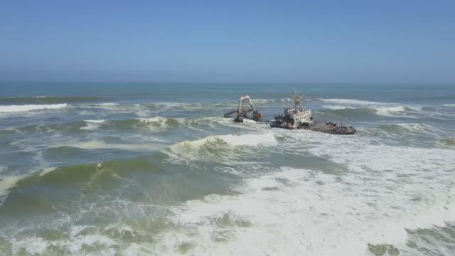 a ship shipwreck near a beach in africa. - crash stock videos & royalty-free footage