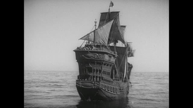 a ship slowly sails the seas - veliero video stock e b–roll
