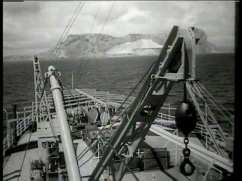 stockvideo's en b-roll-footage met small cargo ship. rock of gibraltar on straight of gibraltar on iberian peninsula, british territory. rock of gibraltar from west, europa point... - west europa