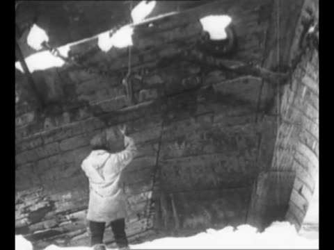 ship stopped in ice, probably explorer robert bartlett's ship ss viking, during arctic exploration / man stands on ice as line is thrown down from... - exploration stock videos & royalty-free footage