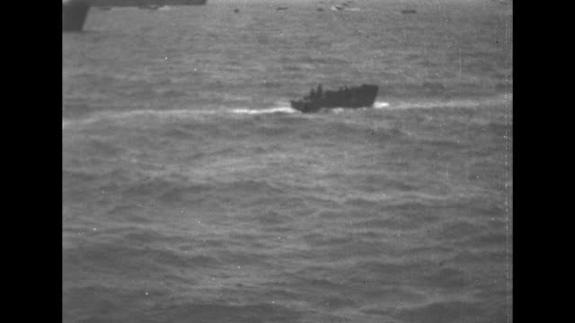 ship structure with churning water below as landing craft with soldiers takes off / ship structure as craft moves behind it / landing crafts on ocean... - incomplete stock videos & royalty-free footage