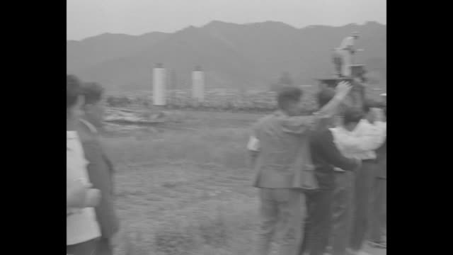"""ship """"takasago maru"""" steams into harbor of maizuru bearing japanese pows returning to japan from soviet prison camps / shot of pows looking out from... - prisoner of war stock videos & royalty-free footage"""