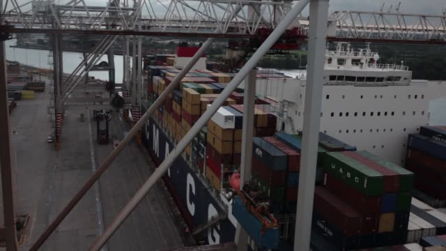 ship to shore cranes load containers onto the cma cgm sa marco polo container ship at the port of southampton jointly operated by dp world ltd and... - straddle carrier stock videos & royalty-free footage