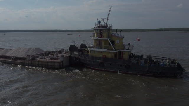 Ship transporting gravel on white sea / rover Volga