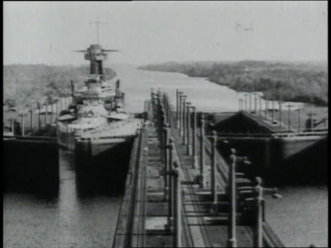 montage ship waiting to go through as gate to panama canal opens long wooden walkway / republic of panama - anno 1906 video stock e b–roll