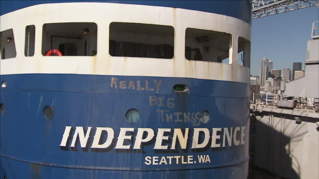 "a ship with the title, ""independence"" sits at a shipyard. - world title stock videos & royalty-free footage"