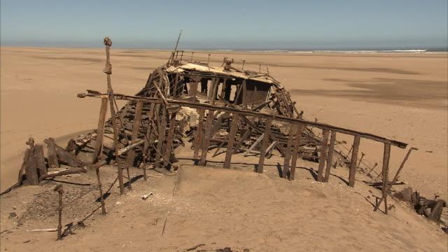 ws, pan, ship wreck on coast of namib desert, skeleton coast, namibia - coastline stock videos & royalty-free footage