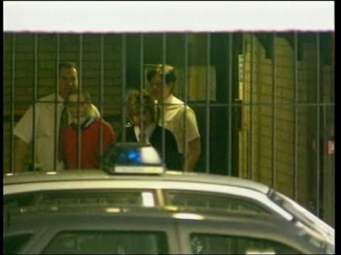 stockvideo's en b-roll-footage met lib shipman from court to prison van in handcuffs - bewegingsbeperkende middelen