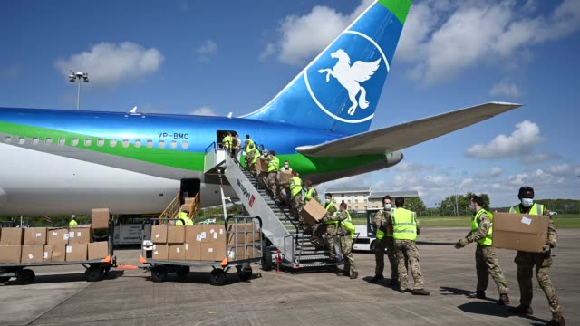 shipment of ppe from hangzhou, china, is unloaded from a plane at cardiff airport on may 1, 2020 in rhoose, wales. the plane is understood to contain... - shipping stock videos & royalty-free footage