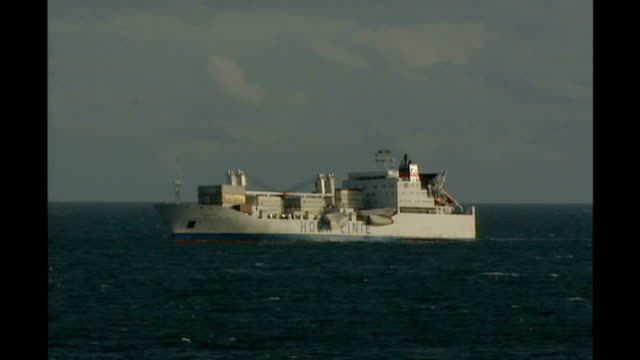 passengers rescued from stricken ship off isles of scilly; england: devon: off falmouth: ext mv horncliff offshore in calm waters today - isles of scilly stock videos & royalty-free footage