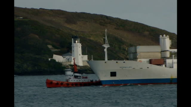 passengers rescued from stricken ship off isles of scilly; mv horncliff being towed to falmouth - isles of scilly stock videos & royalty-free footage