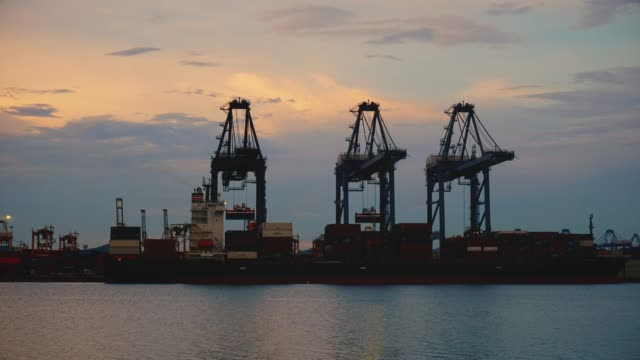 shipping cargo to harbor container ship in export and import business and logistics - cargo ship stock videos & royalty-free footage