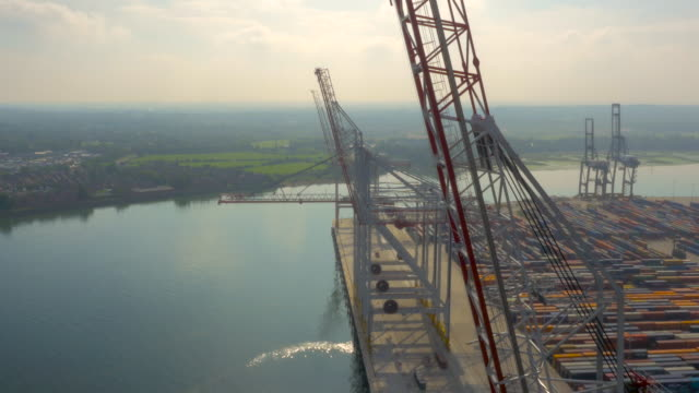 Shipping containers and cranes at Southampton Port, UK filmed by drone