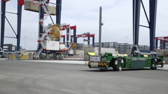 Shipping containers are transported by automated guided vehicles during the testing phase of the Long Beach Container Terminal in Middle Harbor at...