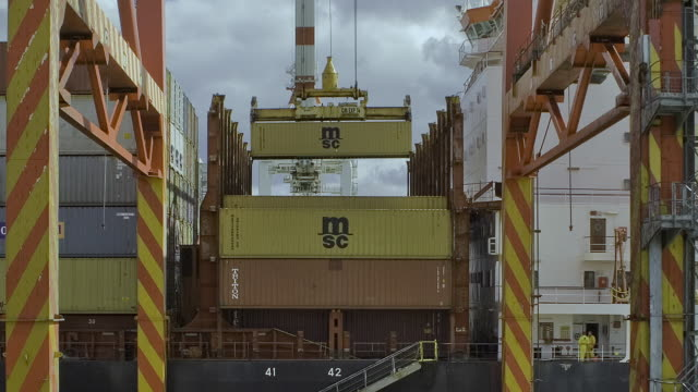 t/l ms zo shipping containers being loading on ship in swanston dock / melbourne, victoria, australia - economy stock videos & royalty-free footage