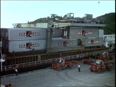 shipping containers being unloaded / shipping container being lowered / shipping container loaded onto a truck - 1968 stock-videos und b-roll-filmmaterial