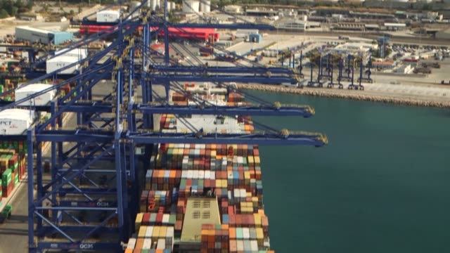 shipping containers sit on the dockside at the cosco pacific ltd terminal at piraeus port operated by piraeus container terminal sa in athens greece... - pct stock videos and b-roll footage