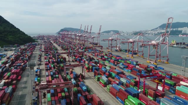 shipping containers sit stacked among gantry cranes in this aerial photograph taken above the busan port terminal in busan south korea on monday july... - crane stock videos & royalty-free footage