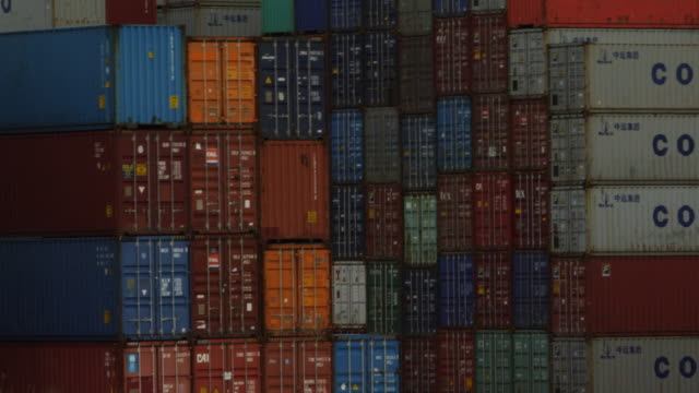 shipping containers stacked at port of rotterdam - container stock videos & royalty-free footage