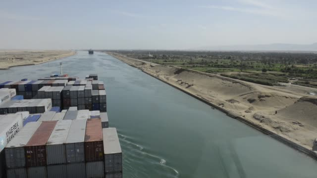 shipping containers stand aboard the ebba maersk, operated by a.p. moeller-maersk a/s, as it passes southbound along the suez canal in egypt passage... - suez canal stock videos & royalty-free footage