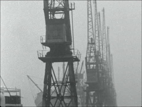 strike at west india docks england london west india docks ext gv ship in deserted docks / ms ditto / cu crane at standstill / ms ditto pan down to... - abandoned stock videos & royalty-free footage
